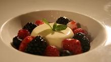 Vanilla panna cotta, fresh berries and strawberry consommé