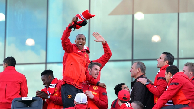 Manchester United players celebrate on an open top bus