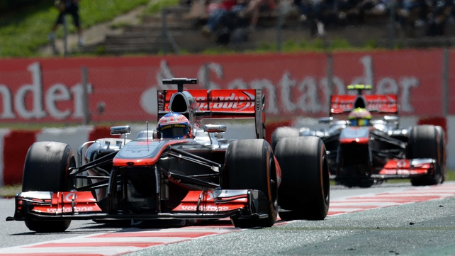 Jenson Button leads team-mate Sergio Perez at Barcelona's Circuit de Catalunya