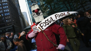 Environmentalists stage a protest to coincide with a fundraising event by US President Barack Obama in New York