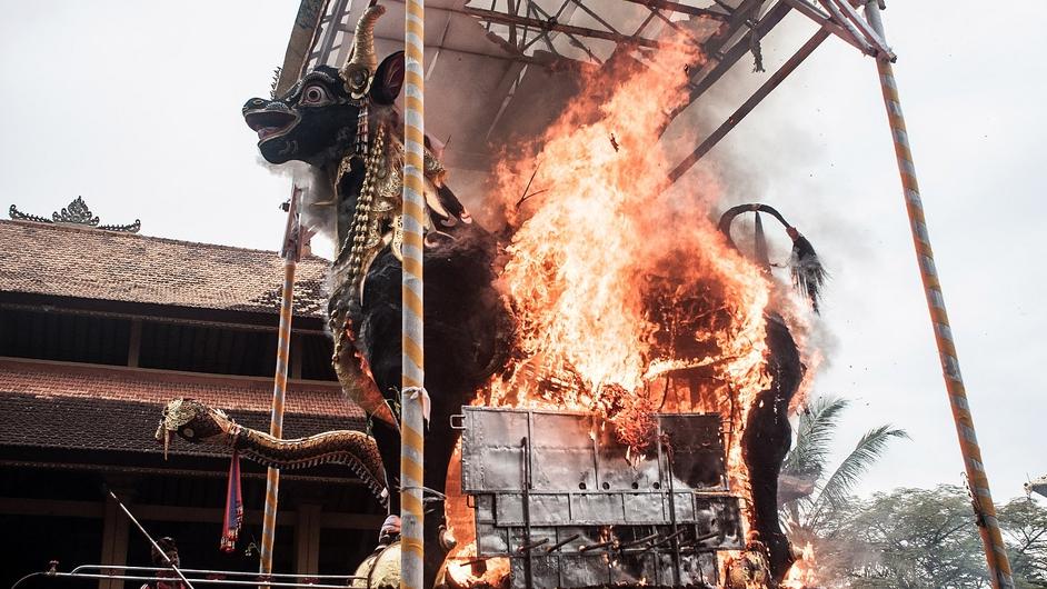 Fire engulfs the black bull sarcophagus containing Indonesian royal Tjokorda Ngurah Wim Sukawati's corpse