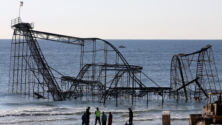 Workers prepare to remove the Star Jet roller coaster that has been in the ocean for six months since Superstorm Sandy hit New Jersey