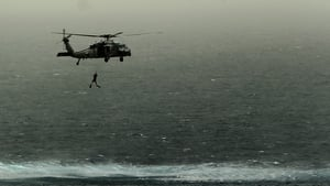 A US Seahawk helicopter drops a diver in the Arabian Sea during a drill to destory mines by placing explosives on them