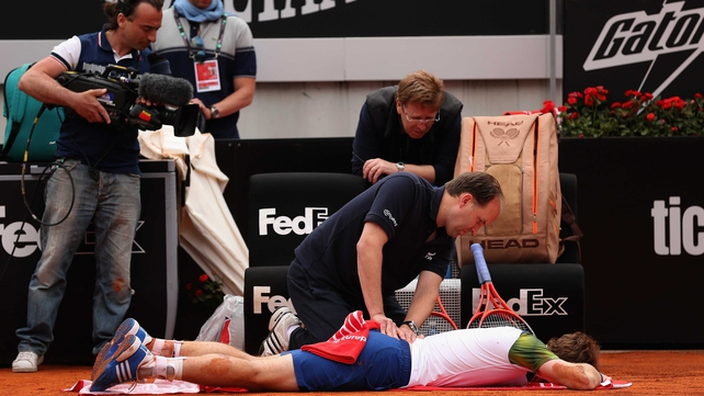 Andy Murray's back problem may force him out of the French Open