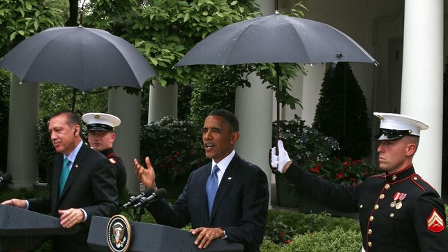 Two US Marines hold umbrellas as Barack Obama and Recep Tayyip Erdogan as they speak to the media at the White House