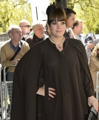 Lily cloaks up at the Ivor Novello Awards