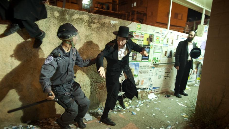 Israeli riot police arrest an ultra-Orthodox demonstrator in Jerusalem