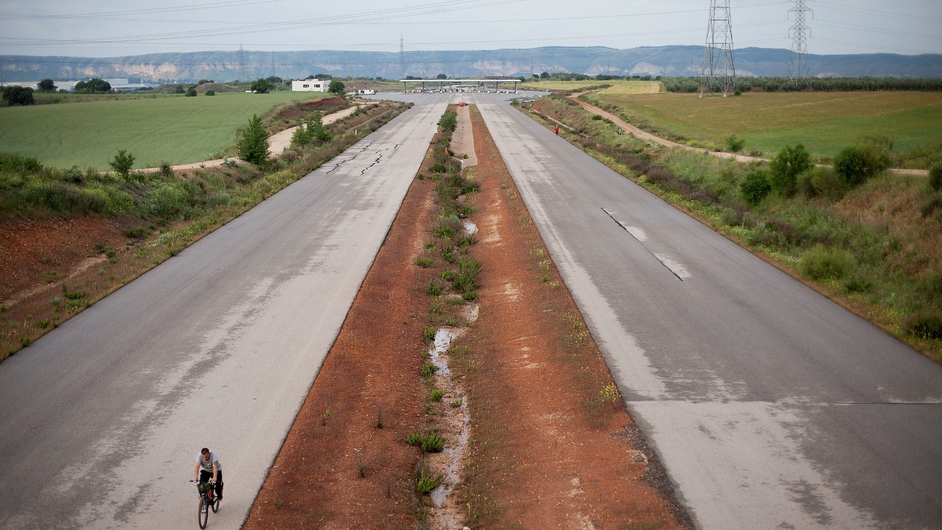 A man cycles along the MP-203 highway project in Madrid, Spain. It was intended to decongest the Barcelona highway but has remained unfinished for six years after an initial investment €70m between 2005 and 2007