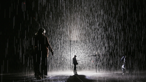 Visitors gather in the new Rain Room installation at the Museum of Modern Art in Manhattan
