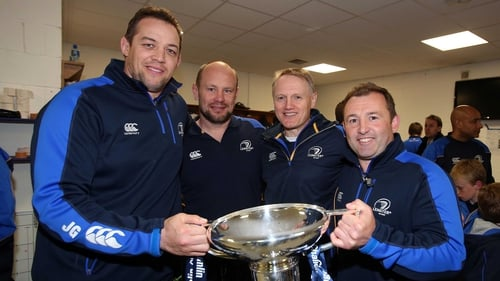 Leinster coaches Jono Gibbes, Greg Feek, Joe Schmidt and Richie Murphy celebrate with the Amlin Challenge Cup