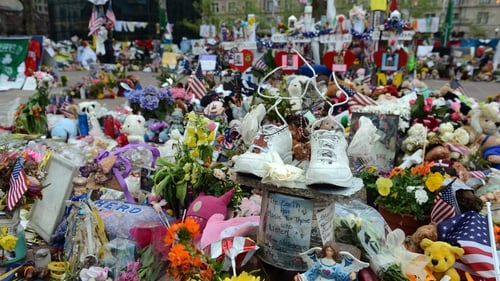 Mr Kenny visited the temporary memorial on Boylston Street in Boston