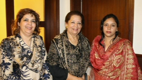 Zahra Shahid Hussain (centre) was shot dead outside her home