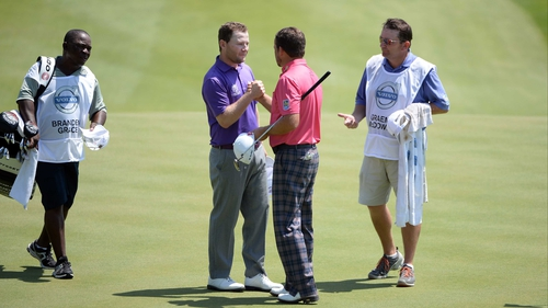 Graeme McDowell is congratulated by Branden Grace in Bulgaria this morning