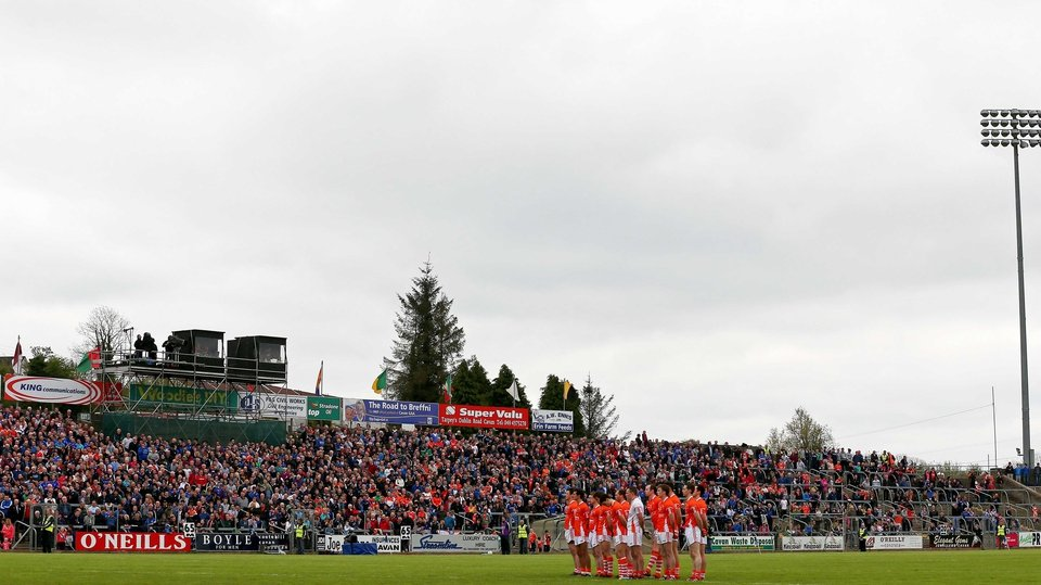 The Armagh team stand for a minute's silence for former GAA president Paddy Buggy who passed away during the week