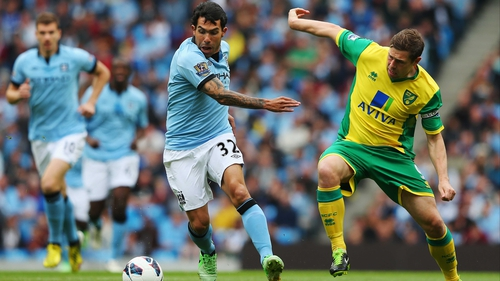 Carlos Tevez protects the balls from Grant Holt