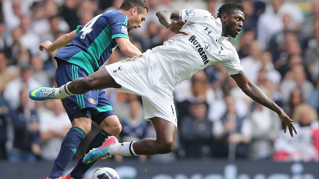 Emmanuel Adebayor takes a tumble