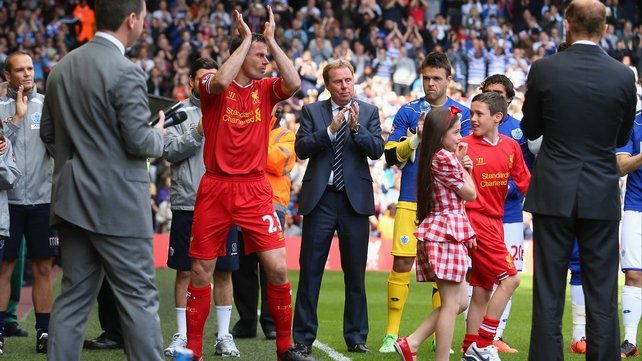 Jamie Carragher is applauded onto the Anfield pitch for his final match