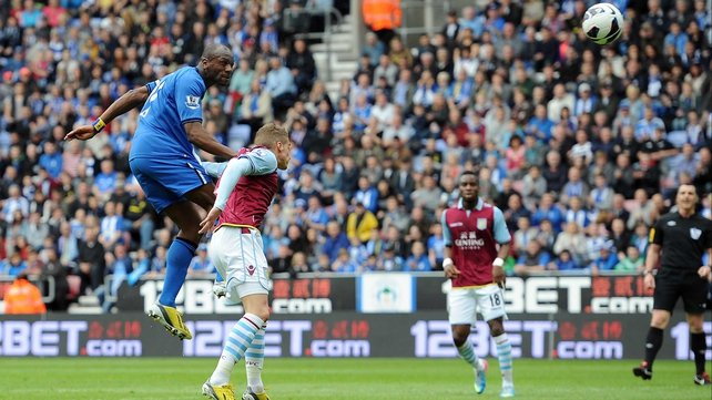Emmerson Boyce of Wigan Athletic heads his side's first goal