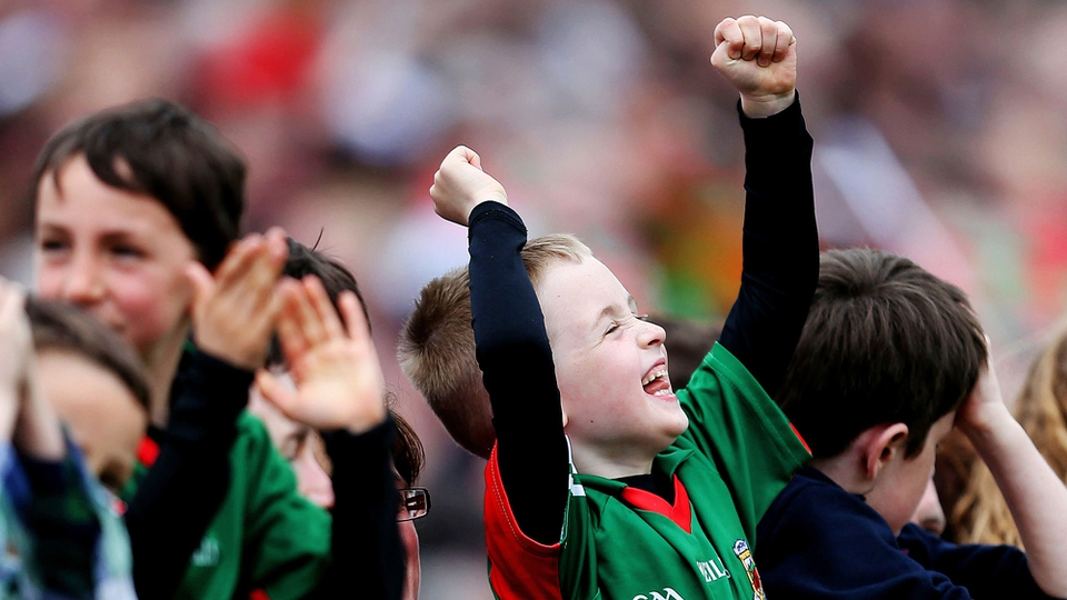 A young Mayo fan punches the air after a score