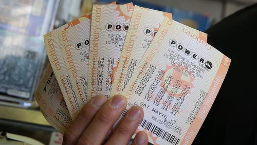 A customer holds $140 worth of Powerball tickets