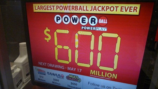 A monitor at a petrol station in Maryland shows the likely lotto jackpot ahead of the draw