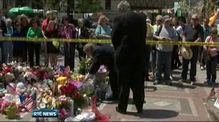 Kenny lays flowers at Boston memorial
