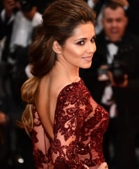 Cole takes to Cannes in backless dress