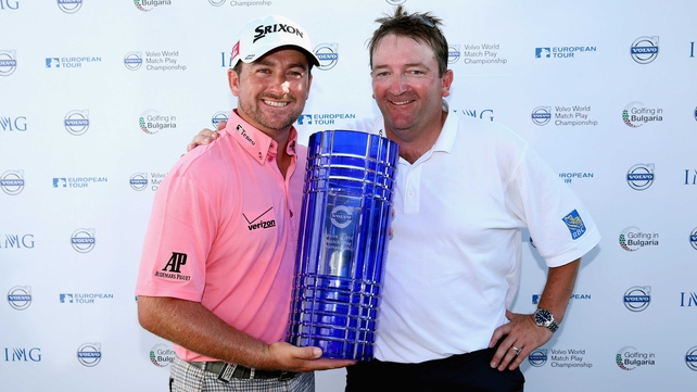 Graeme McDowell poses with his caddie Ken Comboy after winning the Volvo World Match Play Championship