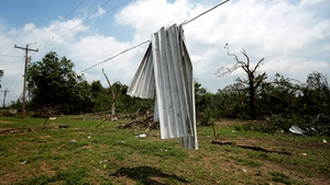 Corrugated tin lies over a power line near Shawnee