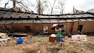 A volunteer helps clear debris