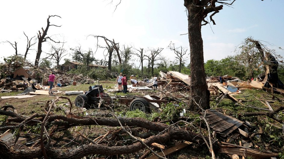 People survey the damage after a tornado swept through Shawnee
