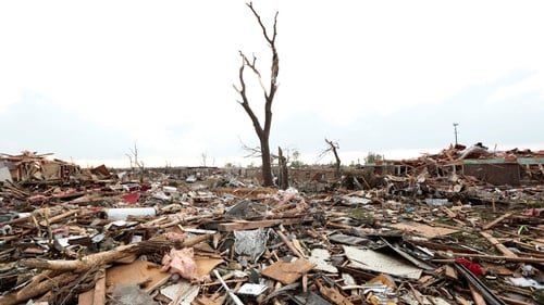 Massive piles of debris cover the ground after the tornado ripped through Moore