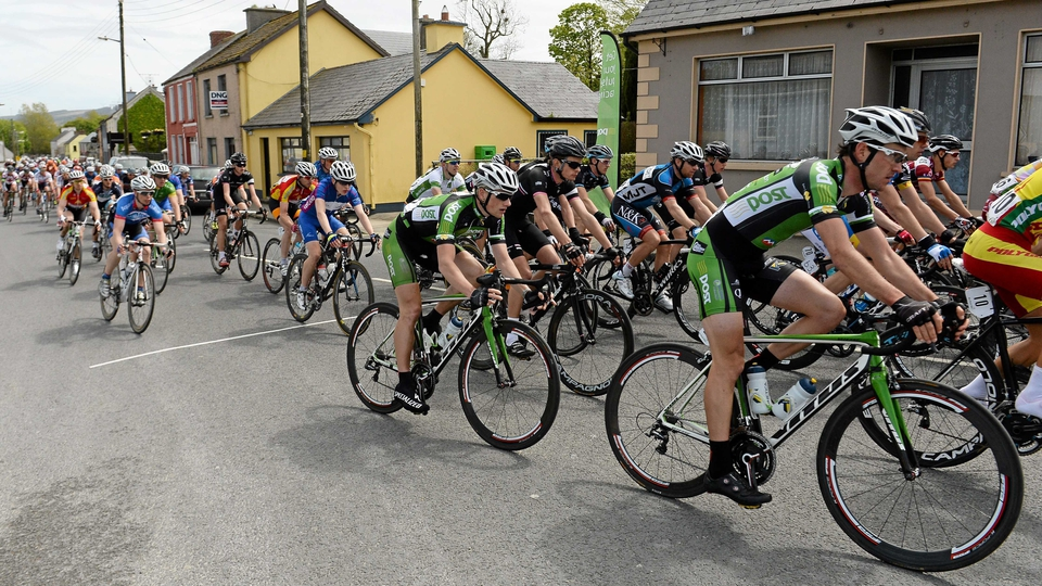 Eventual stage winner Sam Bennett (centre) passes through the village of Athea, Co Limerick