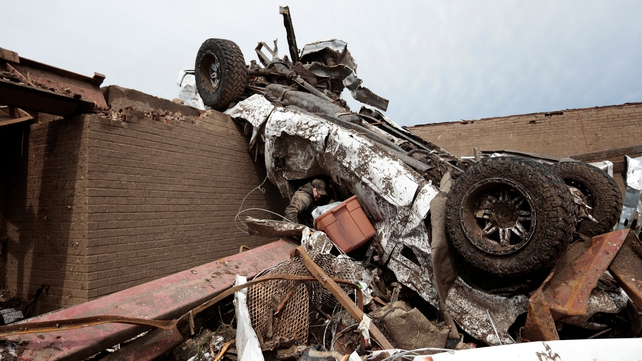 The tornado was powerful enough to flip cars onto the top of buildings