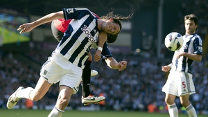 Javier Hernandez and Jonas Olsson get in a tangle during Wigan v Manchester United at The Hawthorns