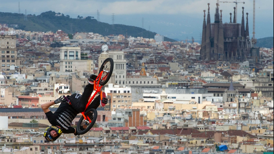 Steve Mccann at the BMX Vert Final during the X-Games in Barcelona with La Sagrada Familia, Gaudi Cathedral in the background