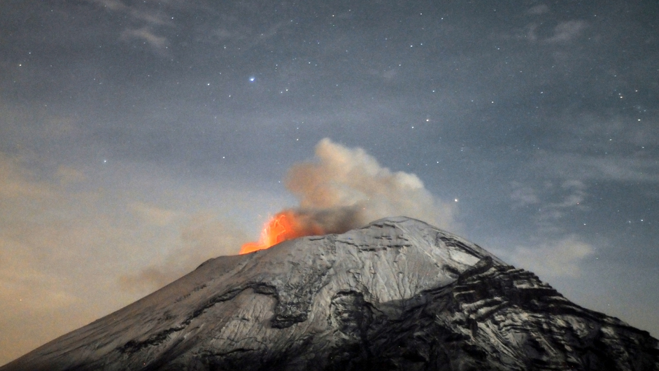 A cloud of ash belches out of Mexico's Popocatepetl volcano, some 55 km from Mexico City, as seen from Paso de Cortes