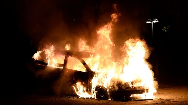 A car was set alight in Kista after youths rioted in a few different suburbs around Stockholm