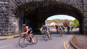 The leading group make their way under a bridge in Killarney, Co Kerry