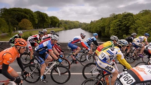 The peloton crosses the bridge leaving Listowel, Co Kerry