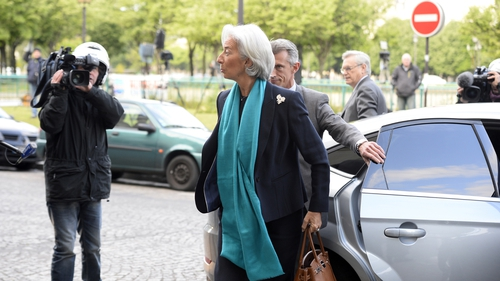Christine Lagarde smiled at reporters as she arrived, saying: 'It's a pleasure to see you'