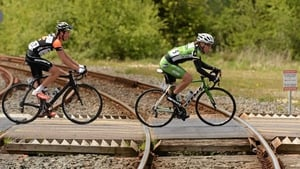 Right to left: Shane Archbold (An Post Chain Reaction) and Michael Northey (NODE4 Giordana) cross a level crossing at Banteer, Co Cork
