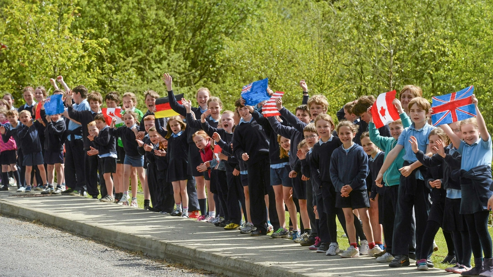 School children cheer on the Rás at Ballylickey, Co Cork