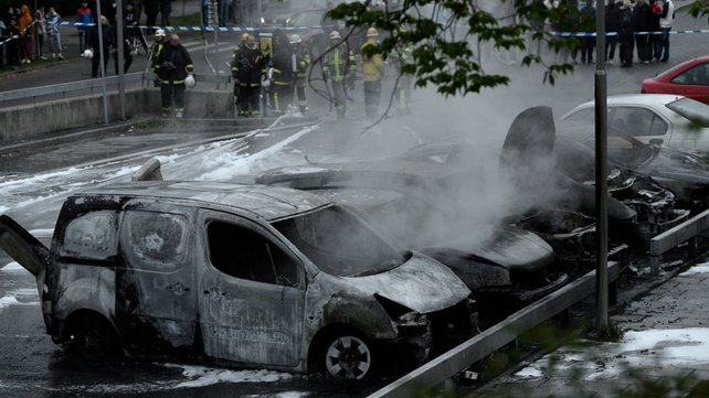 Around 30 cars were set on fire in parts of Stockholm in a fifth night of rioting