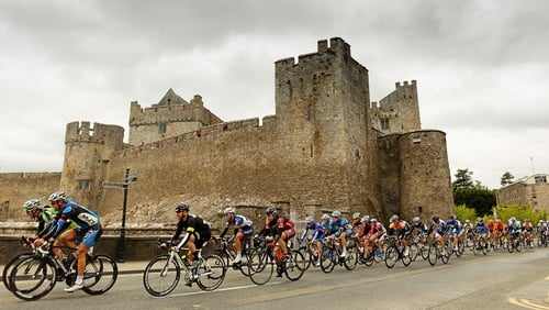 The peloton takes a leisurely spin past Cahir Castle in Co. Tipperary.