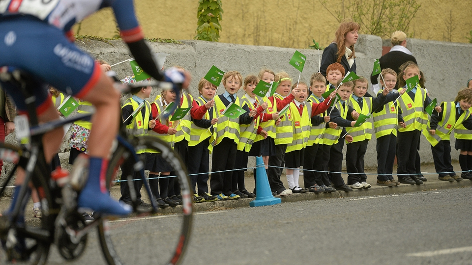Schoolchildren cheer on the Rás at New Inn, Co. Tipperary