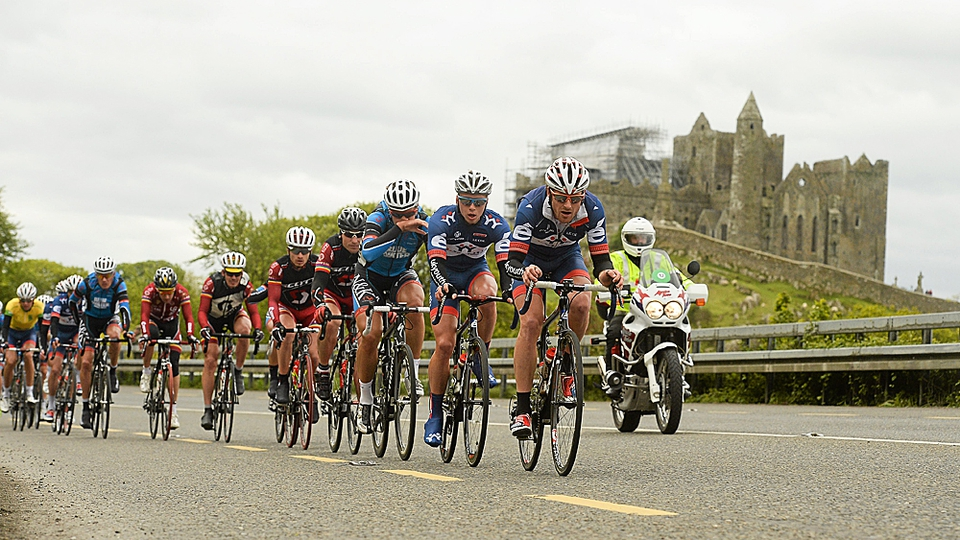 The riders pass the famous Rock of Cashel.