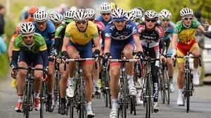 Eyes front. The peloton focuses on their task.
