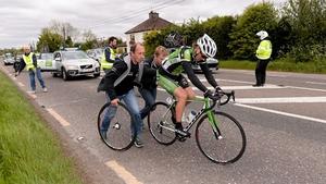 Shane Archbold gets a helping hand following his crash.