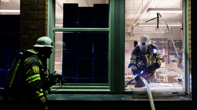 Firemen extinguish a burning school room in the Stockholm suburb of Tensta after youths rioted in few different suburbs around Stockholm and Sweden